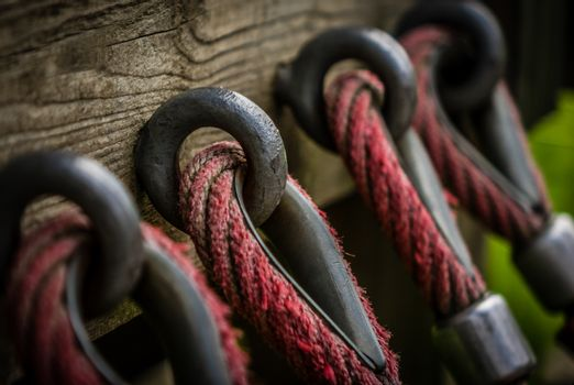 Detail of a rope attached to a wooden wall