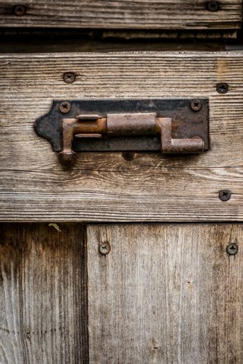 Old rusted lock on a shed in the garden