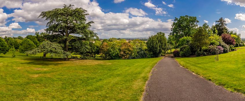 Walking path in a park in spring, England