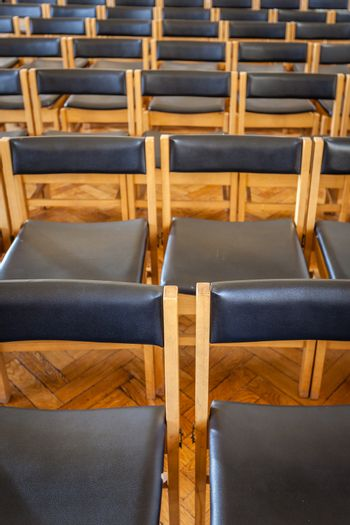 Empty chairs in the church awaiting wedding guests