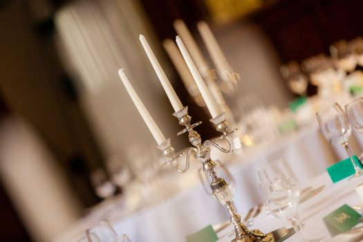 Candlesticks on the tables before wedding reception