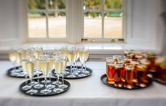 Glasses containing wedding punch and champagne to be served for guests