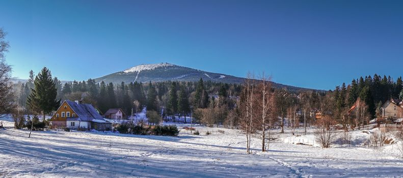 Panoramic view of the winter mountain landscape of Szrenica mountain and Szklarska Poreba, Karkonosze mountains, Poland