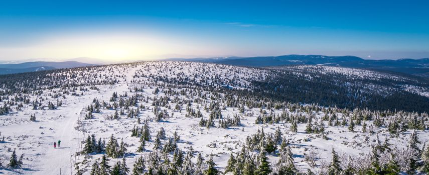 Winter landscape panorama of a Karkonosze mountains as seen from the Szrenica mountain, Poland