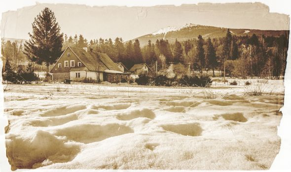 Vintage retro view of the winter mountain landscape of Szrenica mountain and Szklarska Poreba, Karkonosze mountains, Poland
