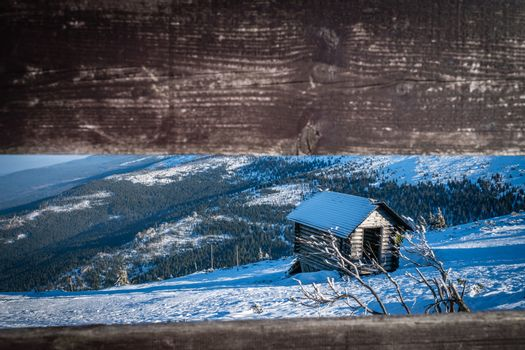 Small wooden hut on the slope of Szrenica mountain in Szklarska Poreba, Karkonosze mountains, Poland