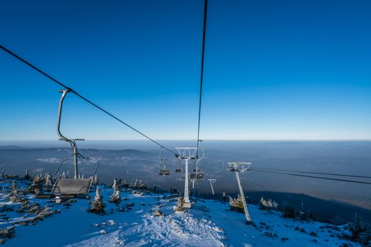 Ski lift up to the top of the Szrenica mountain in Szklarska Poreba resort town, Karkonosze mountains, Poland