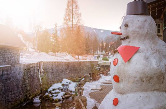Large big fat snowman with red nose and buttons