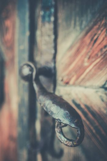 Old brass door handle at the entrance to the traditional home in polish mountain village