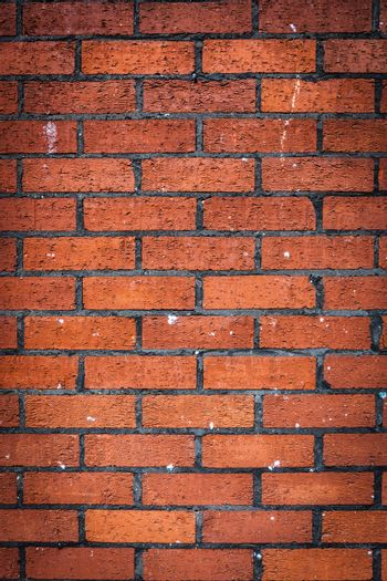 Vertical pattern  of a red bricks wall