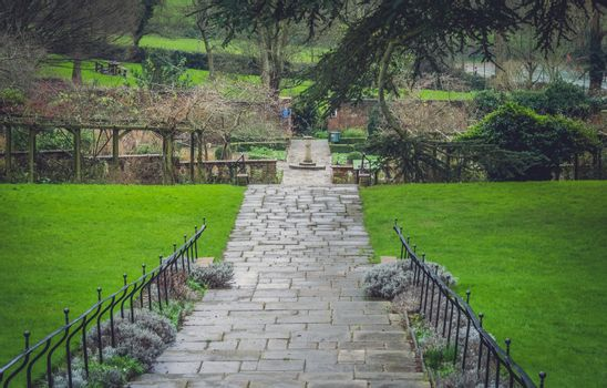 Stony pathway in a public park ( Rookery ) in Streatham in London, summer