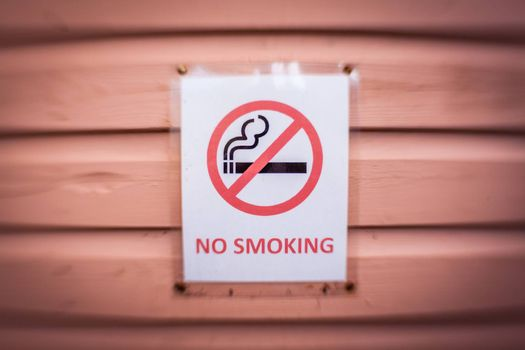 No smoking sign on a wall of a cafe