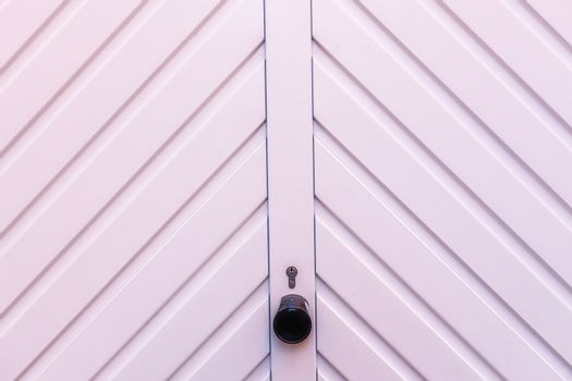 White garage door detail with a lock and keyhole