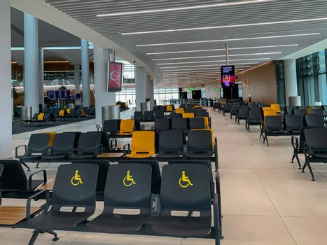 Empty Istanbul airport seats and halls no people during covid-19 corona virus pandemic epidemy in the world quarantine. Horizontal stock image