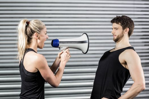 Trainer yelling through the megaphone