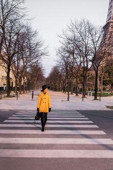 Beautiful girl crossing the street in paris,France