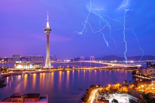 Night view of Macau Tower in Twilight Time  and thunderstorms