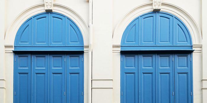 Blue door with wall
