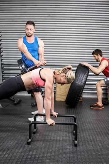 Fit people doing exercises at gym