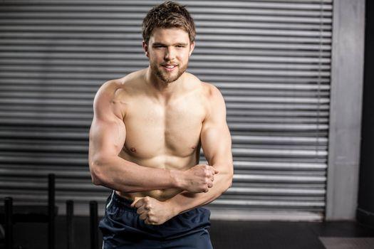 Shirtless man showing his muscle