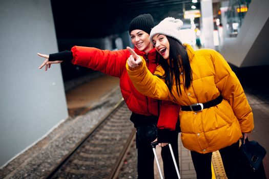 Two young women and train