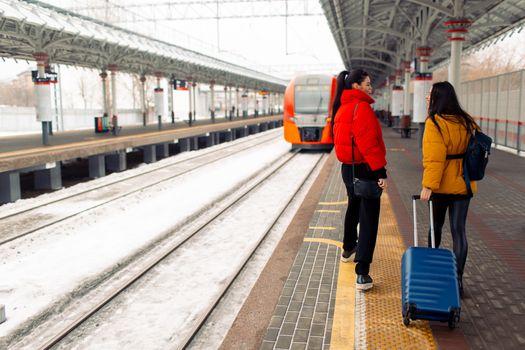 Two young women take train