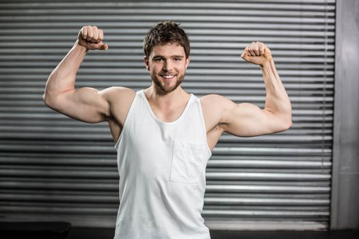 Bodybuilder man flexing his muscles