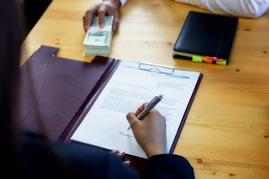 Business woman signing a loan for investment, negotiation