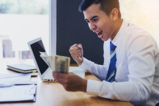 Young business people show joy after successful work. And get big bonuses.