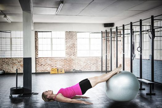 Composite image of woman doing pilates