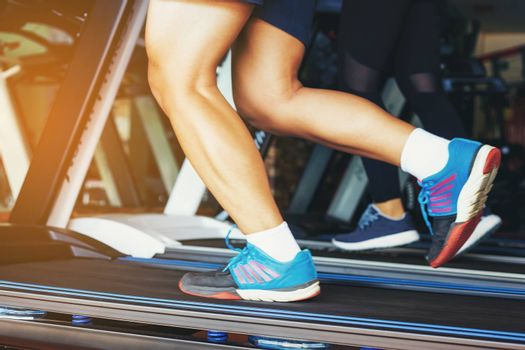 A handsome man running in the gym. The concept of jogging, fitness and a healthy lifestyle.