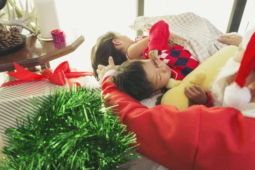 Santa Claus gives gifts to boys and girls listening in the festive season.