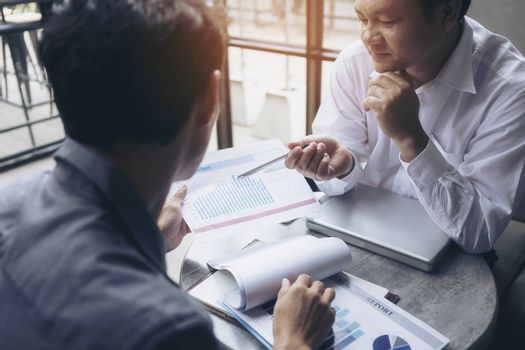 Business people are negotiating business and planning to market.