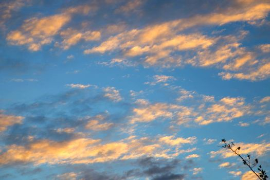 Blue sky with white clouds And the light of the sunset.