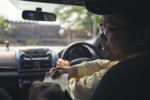 Customer paying for taxi. Cash payments in transportation