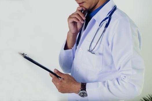 Doctor using a tablet contact with patient. Concepts of technology communication. Medical physician doctor man over clinic background. Doctor.