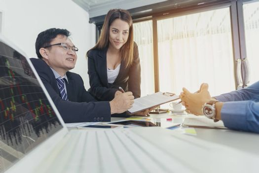 Business - businesspeople have a meeting with presentation in office, they negotiate a contract. Teamwork Concept
