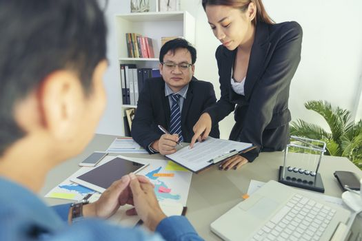 Business - businesspeople have a meeting with presentation in of