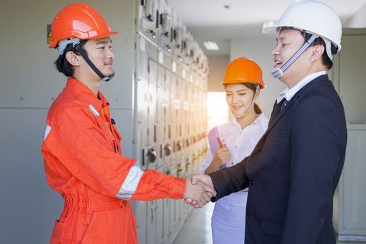 Executives and Electrical Engineers are checking the electrical