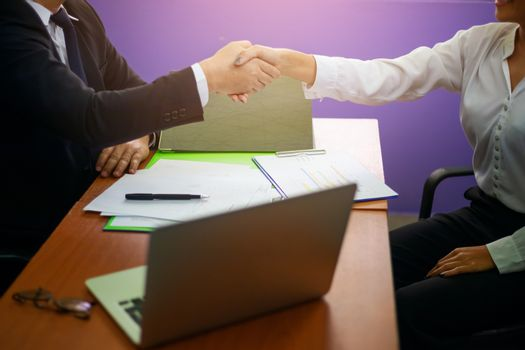 Close up hand of two businessman shaking hand after finish agree