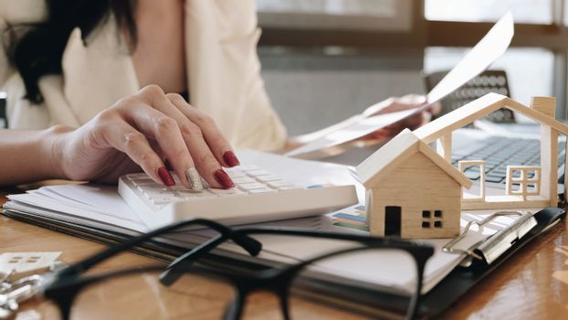 agents working in real estate investment and home insurance sign