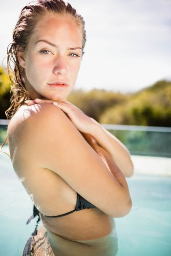 Unsmiling blonde in the pool
