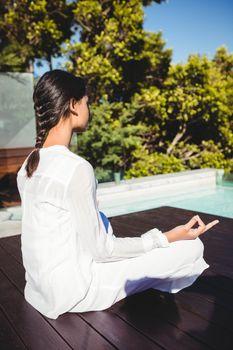 Calm brunette doing yoga
