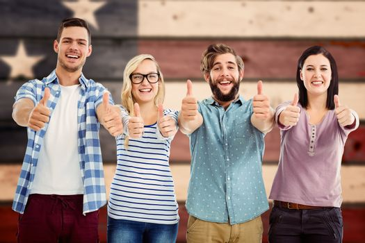 Portrait of smiling business people with thumbs up  against composite image of usa national flag