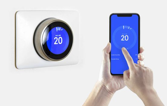 A person using a smart phone application cooling down the room temperature with a wireless smart thermostat on a white background.