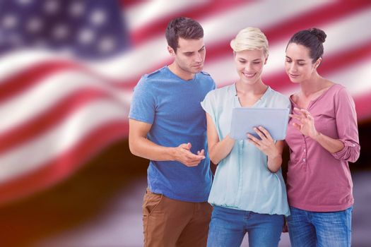 Group portrait of happy colleagues using tablet against composite image of digitally generated united states national flag