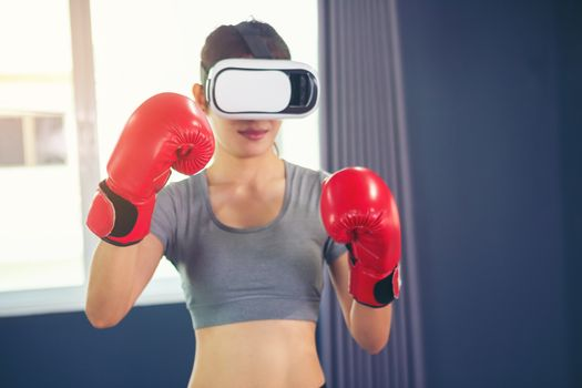 Beautiful woman wearing augmented reality standing in a boxing posture, playing action game simulation, mobile app, female player fighting with fist in a VR headset, technology, high-tech, game con