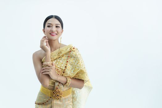 Beautiful Thai girl in traditional costume identity culture of thailand and has a beautiful smile that is a national identity
