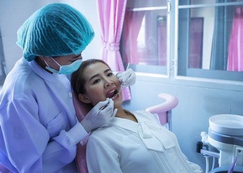 A beautiful woman giving the dentist a dental and oral examination For healthy mouth and teeth