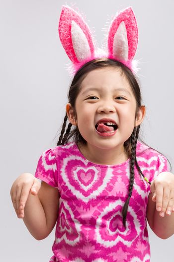 Child wearing bunny ears illustrating Easter concept.